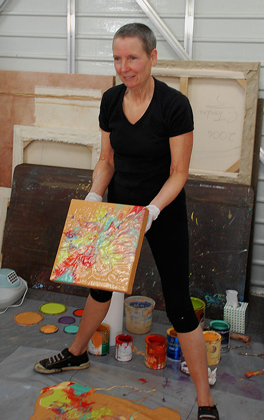 Cassandra Tondro doing a painting demonstration at artist studio tour
